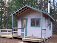 A custom machined log cabin built in California's beautiful Shasta National Park, California by bavariancottages.com