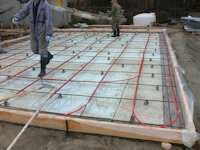 radiant floor heating pipe installed in floor of new shop built by bavariancottages.com