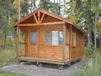 "Machined ""log"" cabin kit made by bavariancottages.com located at Green Lake, BC, Canada"