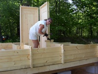 Customer building a cabin kit made by bavarianocottages.com