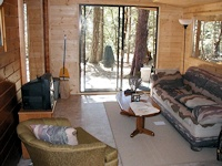 inside the additional room off of the side of the popular Madrona cabin kit made by bavariancottages.com
