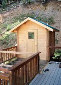 finished outdoors sauna kit manufactured by bavariancottages.com and installed in Wyoming USA